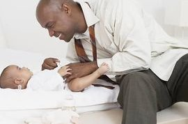Doctor inspecting newborn